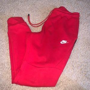 Red Nike jogger pants